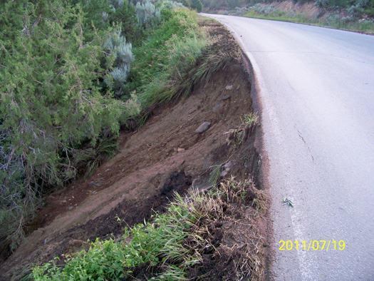 A severe thunderstorm eroded the shoulder of this section of County Road 100.