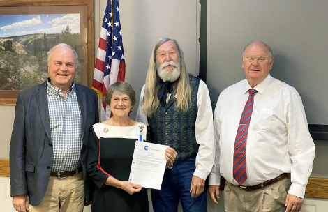 The Garfield County Board of County Commissioners pose with Linda Morcom at a recent meeting.