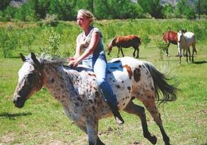 Christian Hope Straw, 14, rides her horse Crystal