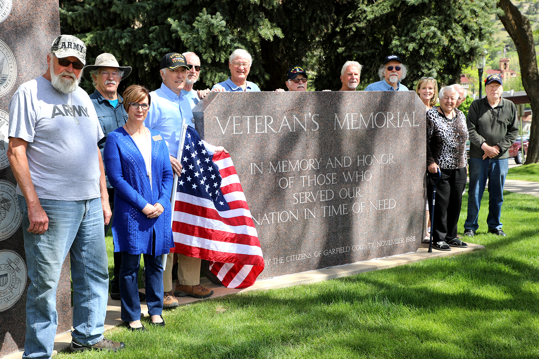 Veterans pose next to the Veteran's Memorial in Glenwood Springs, Colo., on Armed Forces Day 2019.